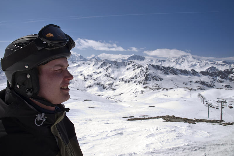 Profile of male skier with the mountains royalty free stock image