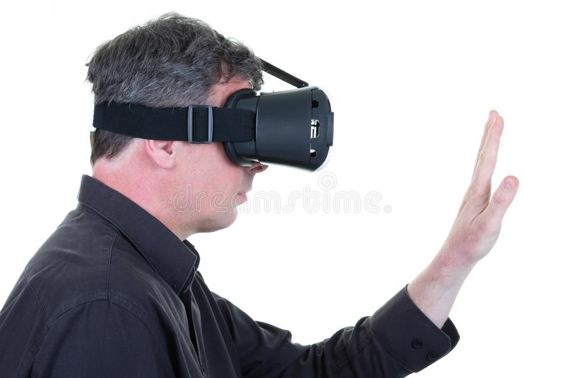 Profile man with vr headset on white background. A profile man with vr headset on white background stock image