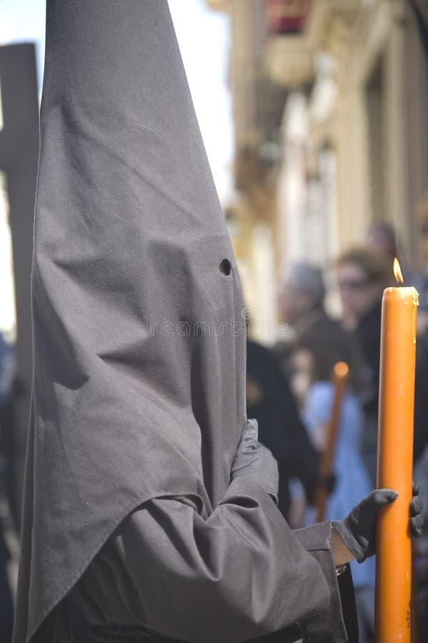 Profile Nazarene holding candle royalty free stock photo