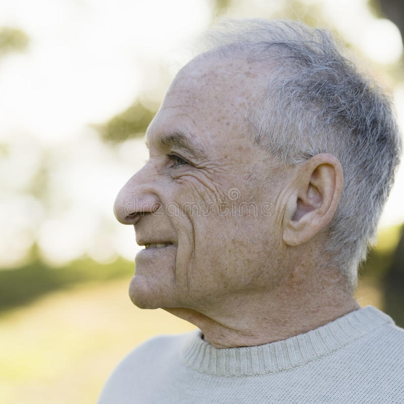 Profile of Old Man stock images