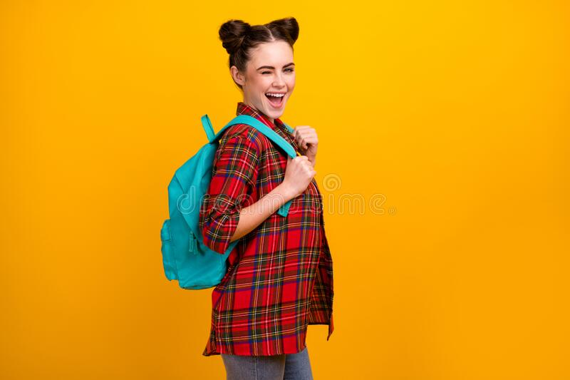 Profile photo of beautiful student lady flirty winking eye first study day walk college lesson lecture wear blue bag. Profile photo of beautiful student lady royalty free stock images