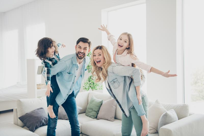 Profile photo of four family members having best free time pretend flight airplane indoors apartments royalty free stock photography