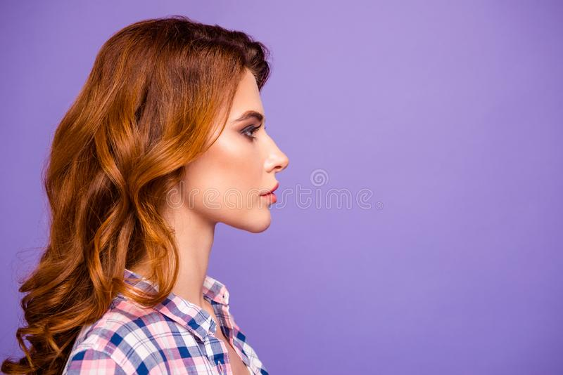 Profile photo of pretty foxy lady looking attentively empty space wear checkered casual shirt isolated purple color royalty free stock images