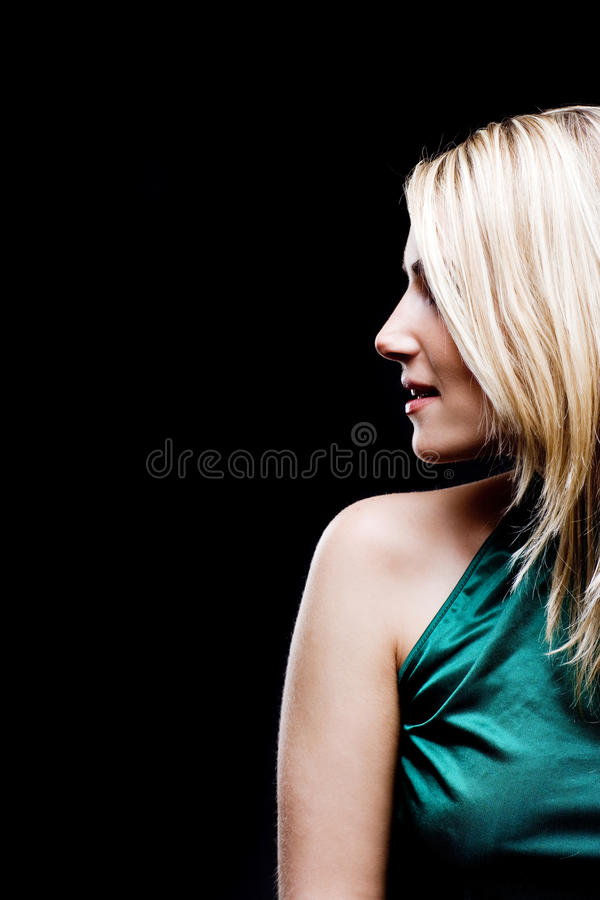 Profile portrait of a beautiful blond woman royalty free stock image