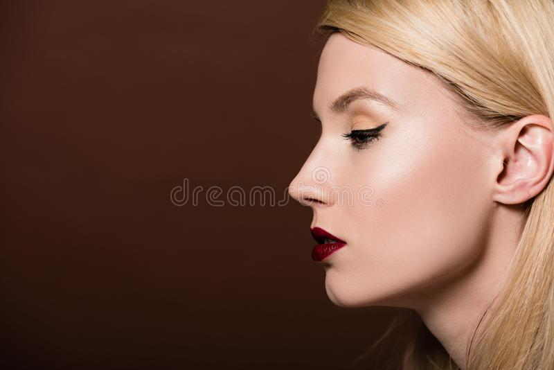 profile portrait of beautiful young blonde woman looking away royalty free stock photo