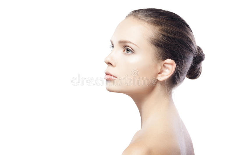 Profile portrait of beautiful young woman with clean skin. Isolated on white background stock images
