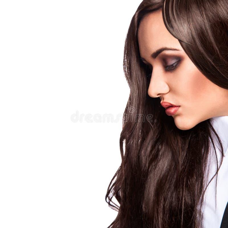 Profile portrait of beautiful young woman in studio stock photo