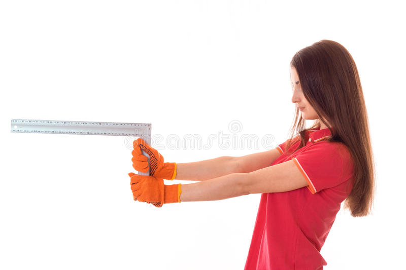 Profile portrait of beauty brunette lady builder makes renovation isolated on white background stock photography