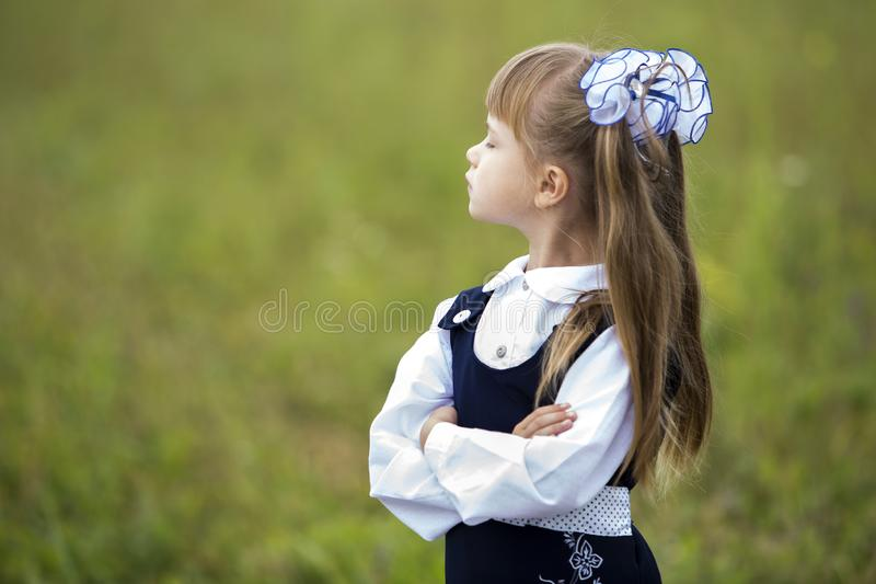 Profile portrait of cute adorable first grader girl in school un stock photo