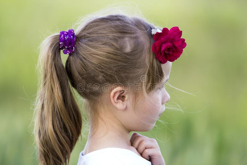 Profile portrait of cute small serious girl in white T-shirt wit stock images