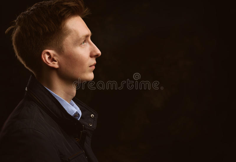 Profile portrait of a handsome young man royalty free stock photography