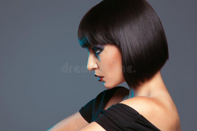 Profile portrait of lovely brunette stock image