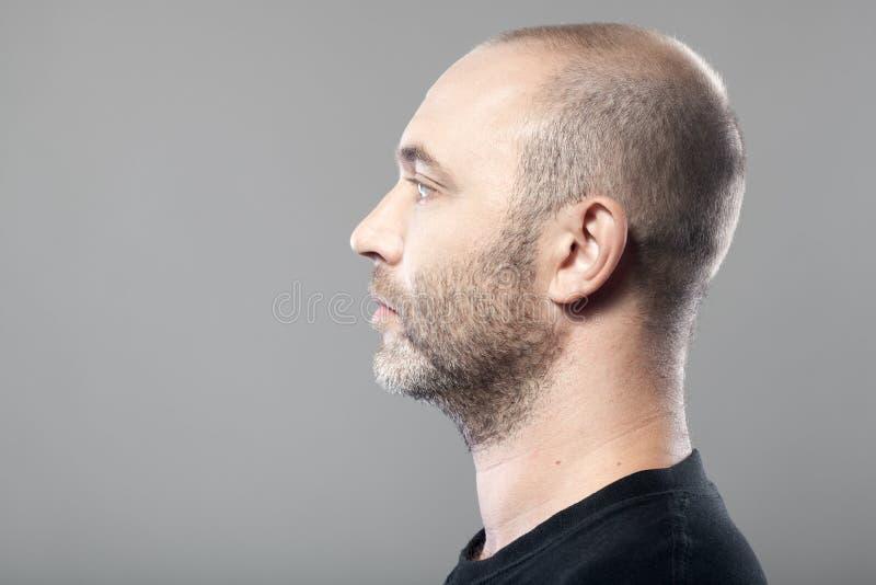 Profile portrait of man on gray background stock image