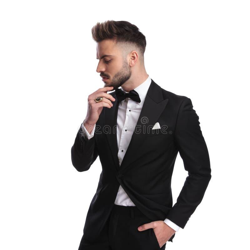 Profile portrait of a pensive elegant man in ceremony suit stock photography