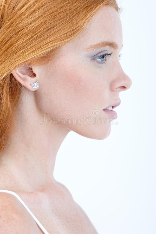 Profile portrait of pure beauty with red hair. Side view royalty free stock photos