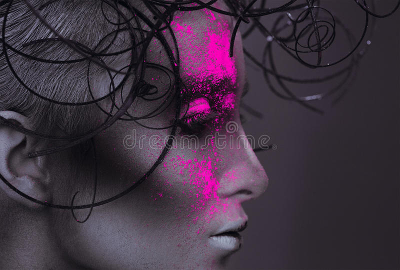 Profile portrait of adult woman with powder on face stock photos
