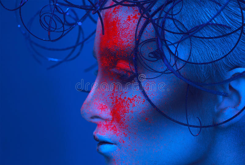 Profile portrait of adult woman with powder on face royalty free stock image