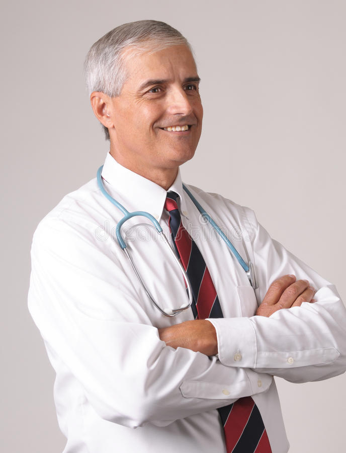 Download Profile Portrait Of Smiling Middle Aged Doctor Stock Image - Image: 11657437