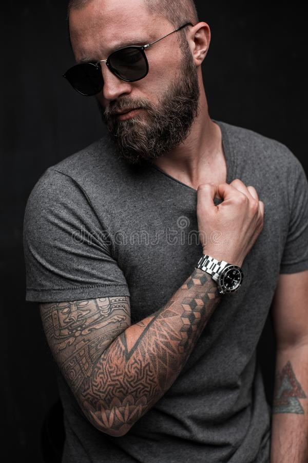 Profile portrait on turned head and long well trimmed beard of handsome man with sunglasses royalty free stock images