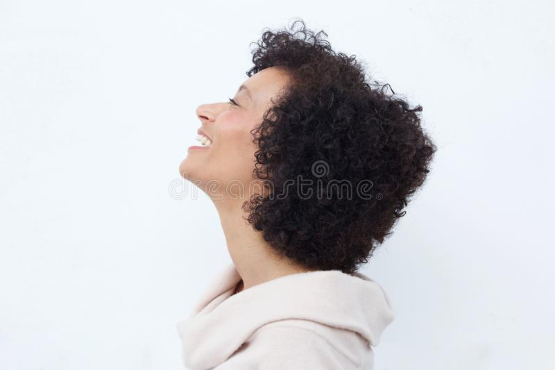 Profile portrait of woman laughing against white background royalty free stock image