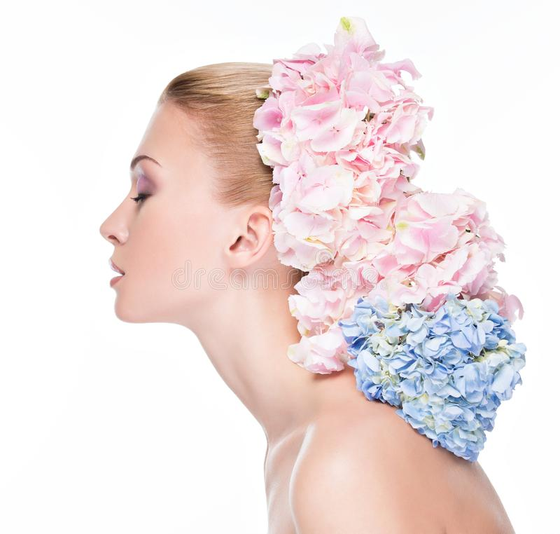 Profile portrait of young beautiful woman with  flowers royalty free stock photos