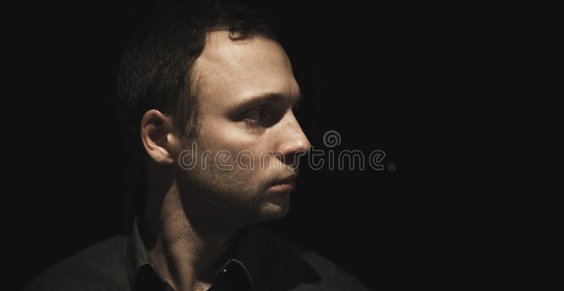 Profile portrait of young European man royalty free stock image