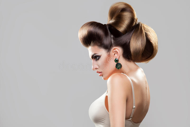 Profile portrait of young woman with creative hairstyle and stock photo