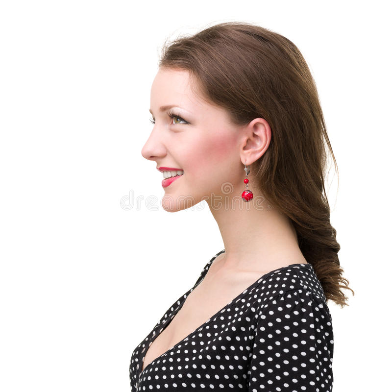 Profile portrait of young smiling woman, isolated on white stock photo