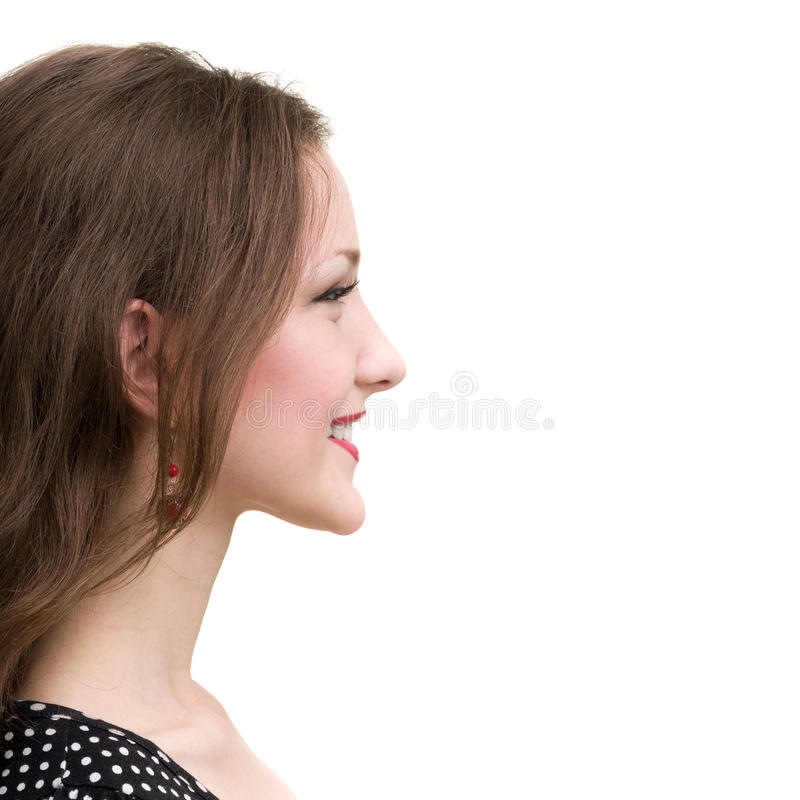 Profile portrait of young smiling woman, isolated on white royalty free stock photography
