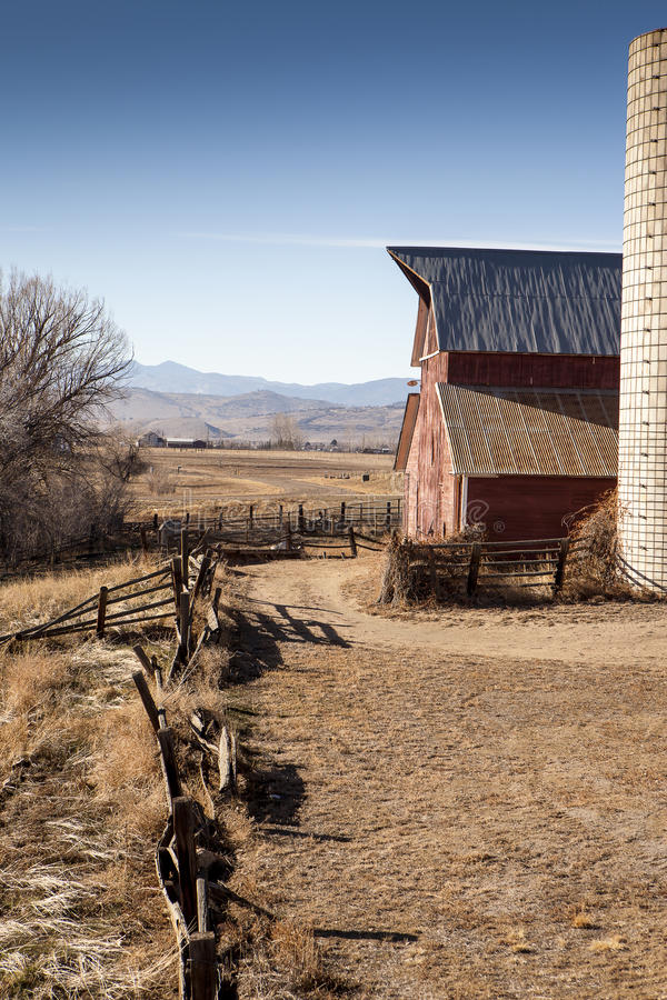 Profile of a red barn and silo stock photos