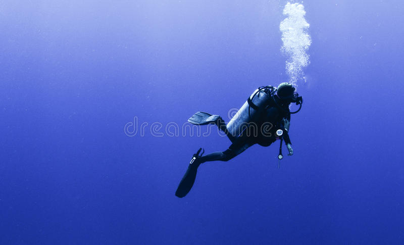 Profile of scuba diver with bubbles royalty free stock photos