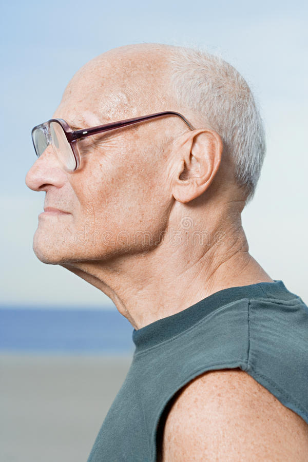 Profile of a senior man stock images