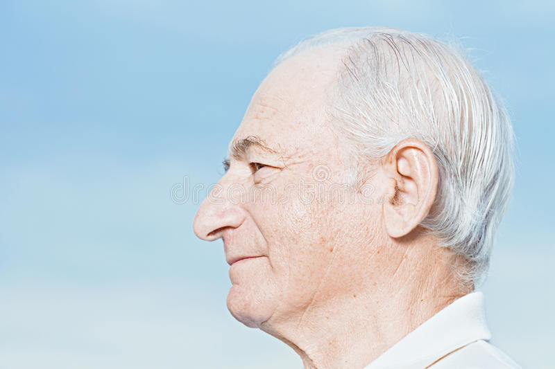 Profile of a senior man royalty free stock image