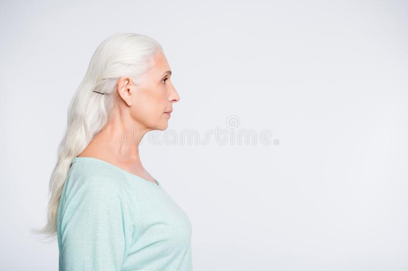 Profile side photo of attractive person looking wearing turquoise sweater isolated over white background royalty free stock photo