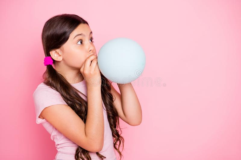 Profile side photo of cute kid hold baloon inflate look dressed white t-shirt  over pink background royalty free stock photo