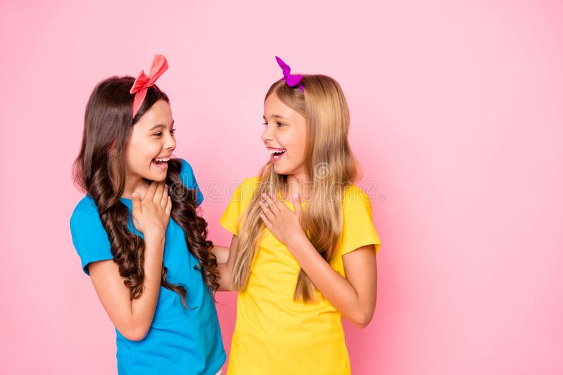 Profile side photo of cute kids look laugh have free time touch chest hands wear headband isolated over pink background. Profile side photo of cute, kids look stock images