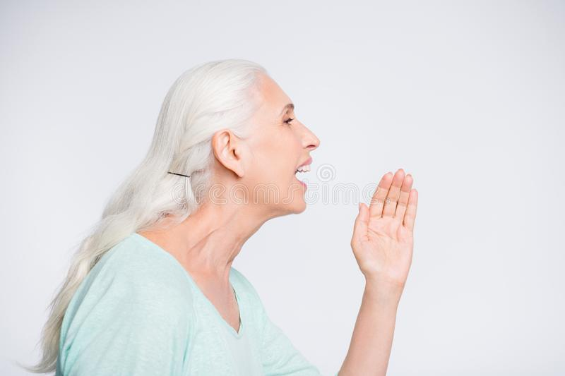 Profile side photo of cute lady screaming shouting promo wearing teal sweater isolated over white background royalty free stock photography