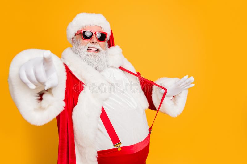 Profile side photo of funky fat santa claus point index finger choose who will party with him on x-mas celebration pull stock images