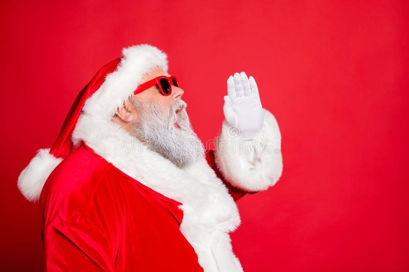 Profile side photo of funny santa claus screaming promotion newyear resolution wearing eyeglasses eyewear bright hat. Profile side photo of funny santa claus royalty free stock image