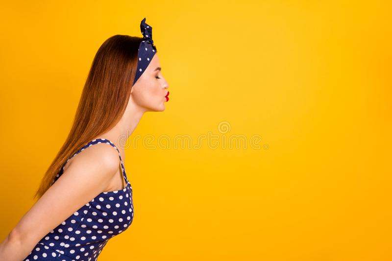 Profile side photo of lovely charming youth send air kiss have date attract boyfriend close eyes isolated over yellow. Profile side photo of lovely charming royalty free stock images