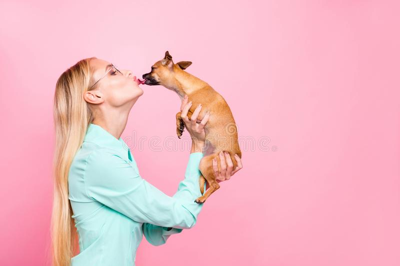 Profile side photo of lovely person having eyeglasses eyewear hold doggy liking her wearing mint color shirt isolated. Profile side photo of lovely, person royalty free stock photo