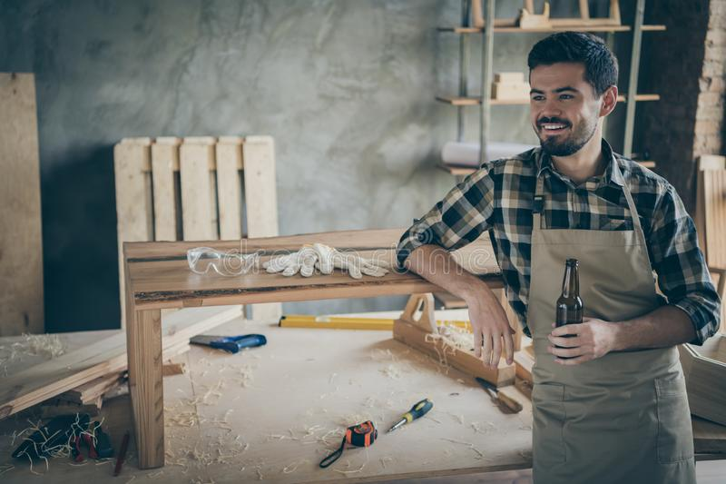 Profile side photo of positive cheerful worker hardwood worker complete his renovation slab table order relax rest hold royalty free stock photo
