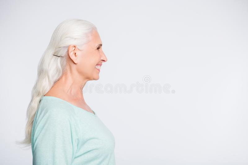 Profile side photo of pretty lady looking smiling wearing teal jumper isolated over white background royalty free stock photo