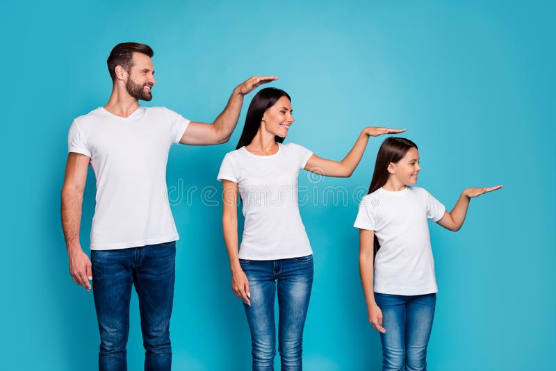 Profile side photo of sweet parent and their daughter with brunet hair holding hand looking wearing white t-shirt denim stock photography