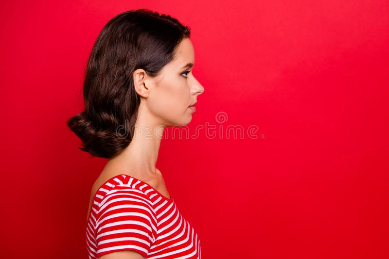 Profile side view photo of concentrated charming pretty lady ready work solve solution lovely feel peaceful calm dressed. Fashionable outfit isolated red royalty free stock photos