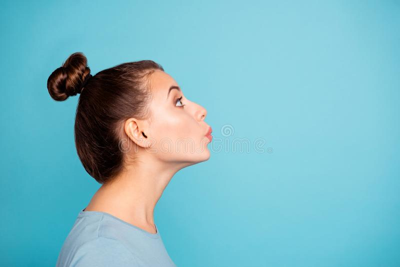 Profile side view photo of cute pretty lovely teen teenager tune whistling look up enjoy feel content glad free time stock photos