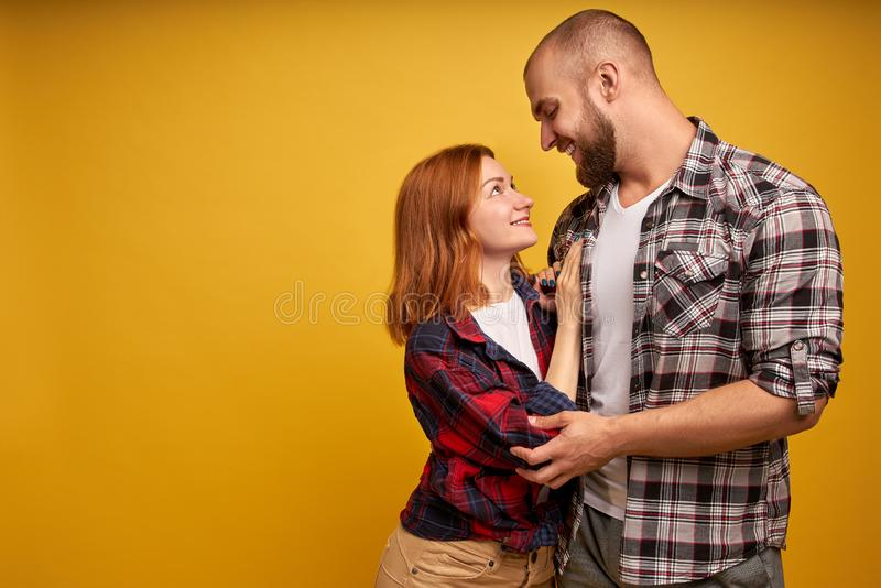 Profile side view photo of handsome boyfriend girlfriend ready for kiss hugs touching looking into eyes dressed in royalty free stock images