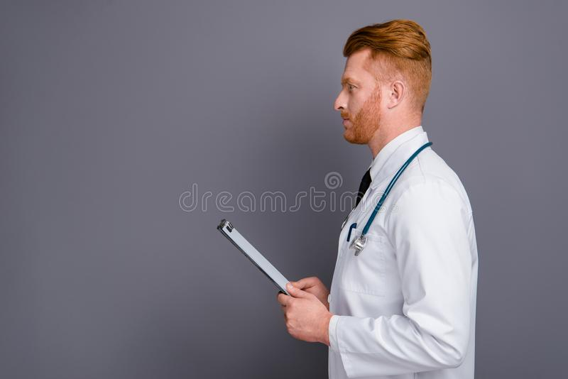 Profile side view photo of nice calm doctor isolated on dark gra stock images