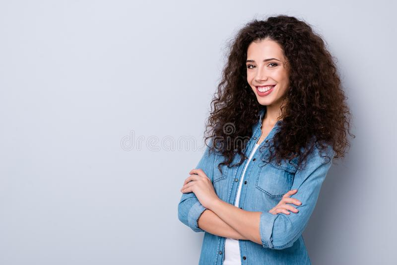 Profile side view portrait of her she nice cute pretty charming winsome attractive lovely cheerful cheery wavy-haired. Girl folded arms over gray pastel royalty free stock image