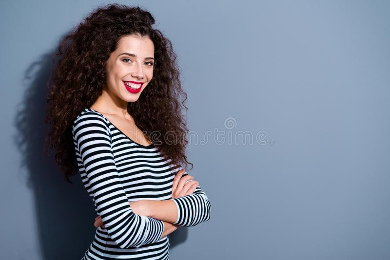 Profile side view portrait of her she nice-looking cute charming attractive lovely cheerful cheery wavy-haired lady in. Striped pullover over gray pastel royalty free stock photo